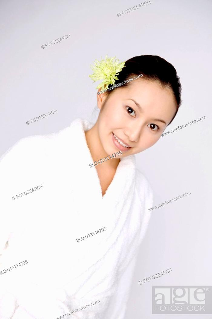 Stock Photo: Woman wearing a bathrobe.