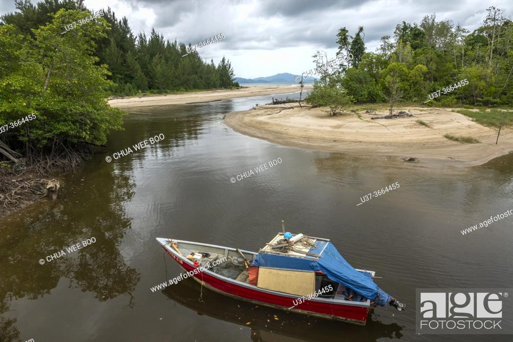 Stock Photo: Small fishing boat berthed at Kem Pueh, Sematan, Sarawak, East Malaysia.