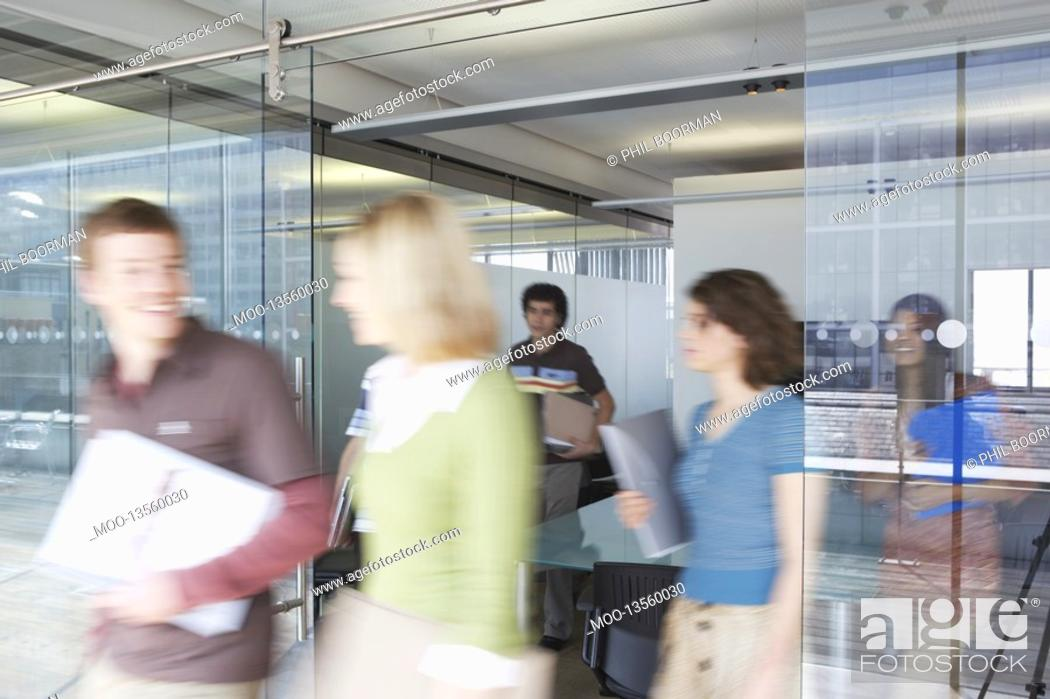 Stock Photo: Office workers leaving conference room long exposure.