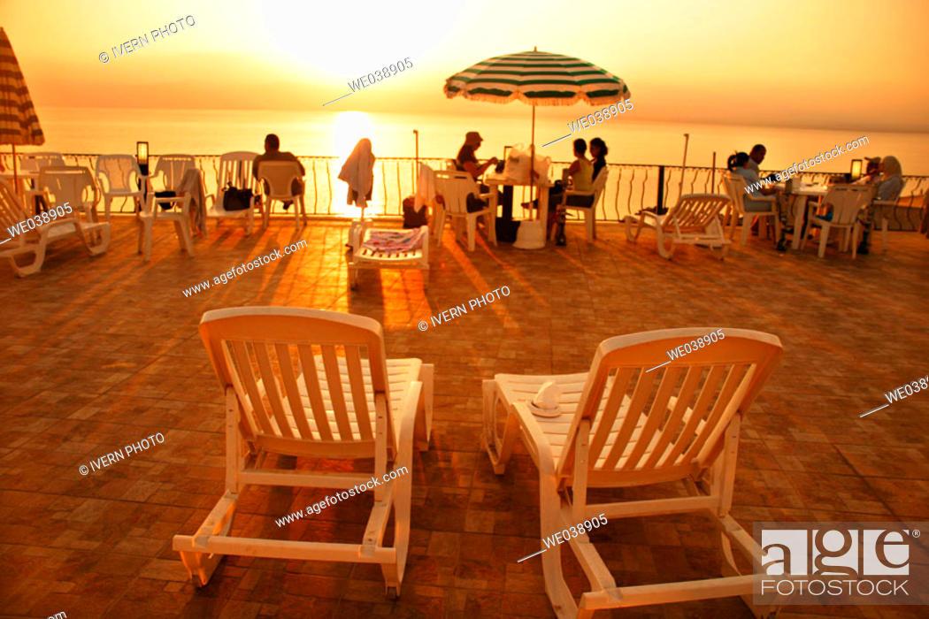 Stock Photo: Dead Sea tourist resort at sunset, Jordan.