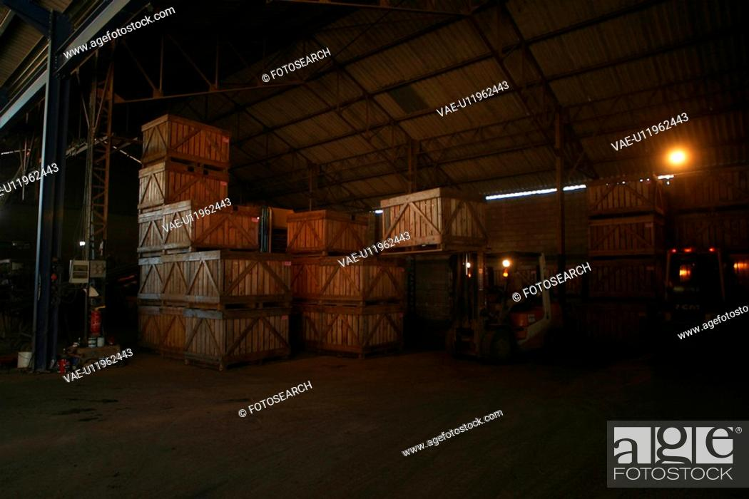 Stock Photo: worker, working, effort, factory, warehouse, carrying.