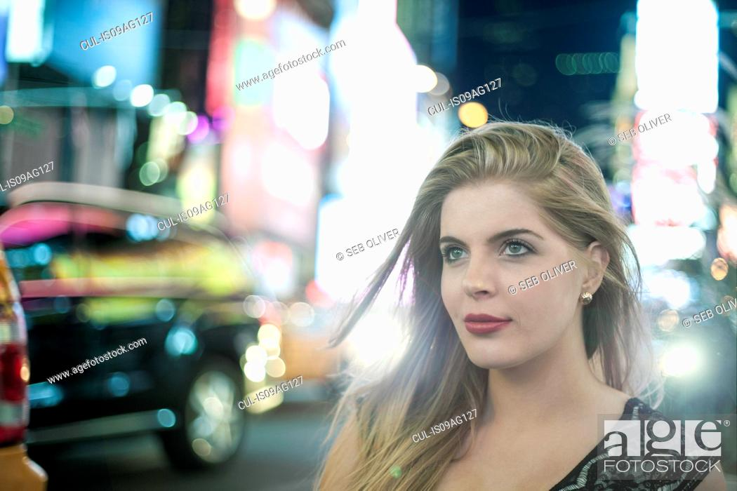 Photo de stock: Young woman on night out, New York City, USA.
