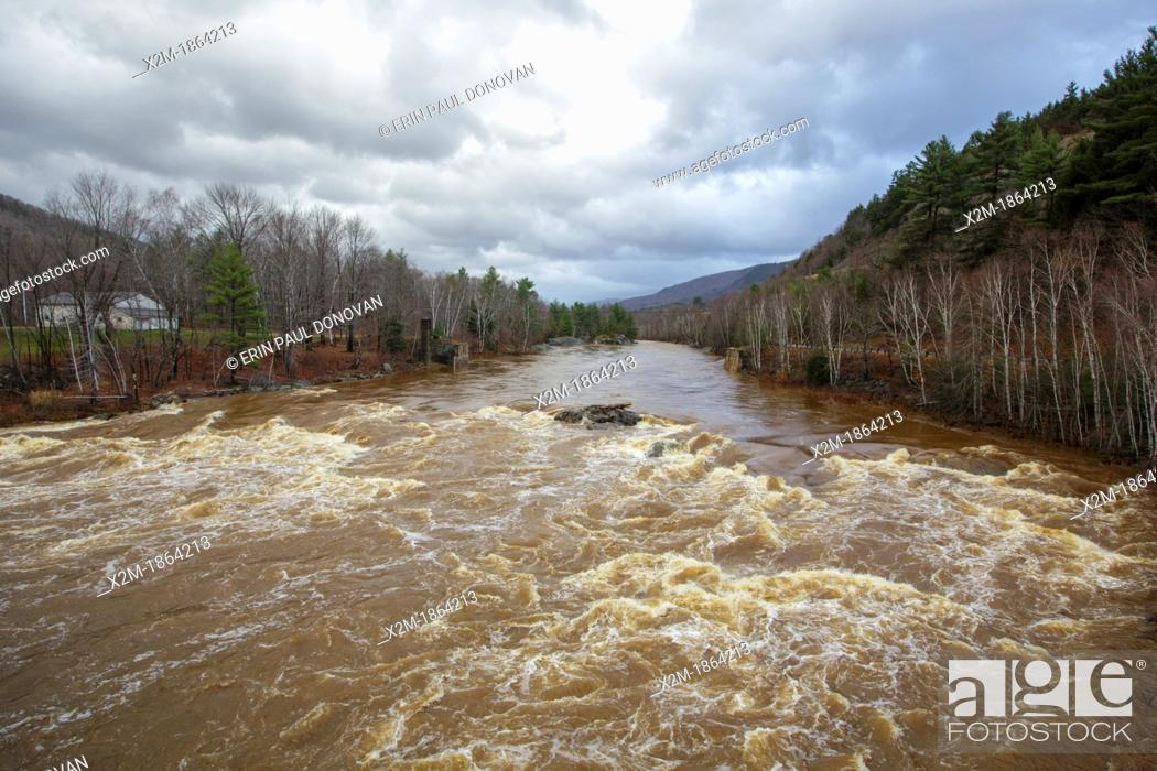 Stock Photo: The Pemigewasset River in Woodstock, New Hampshire USA after hours of heavy rains and strong winds from Hurricane Sandy  Hurricane Sandy caused massive.