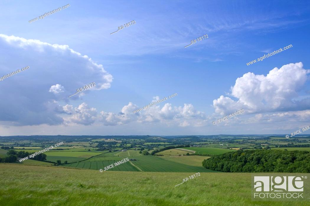 Stock Photo: Clouds in blue sky over countryside.