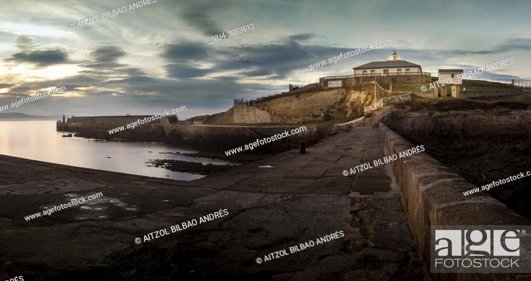 Stock Photo: Sunset at Tapia de Casariego lighthouse, Asturias, Spain. The north coast from Spain have's a lot of beautiful lighthouses like this.