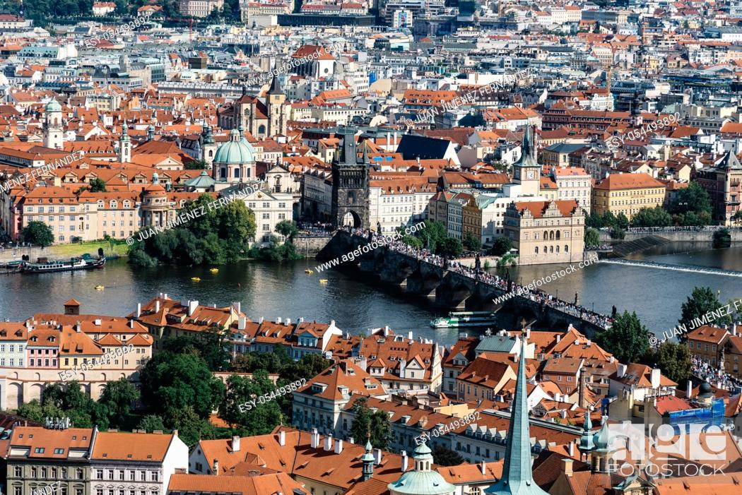 Stock Photo: Cityscape of Prague from tower of Cathedral. Charles Bridge.