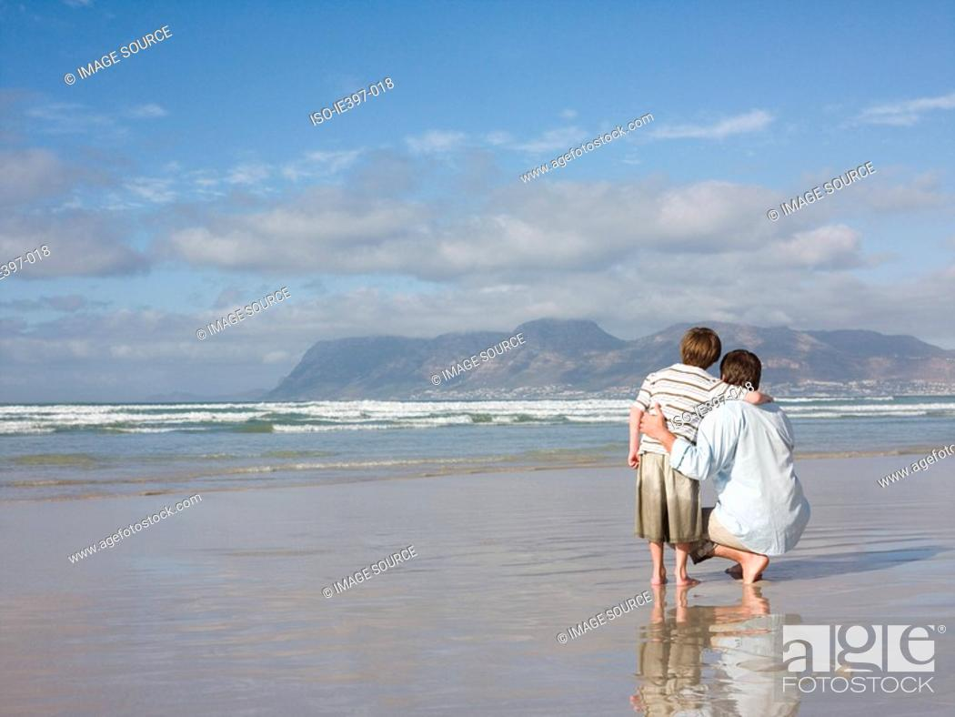 Stock Photo: Father and son by the sea.