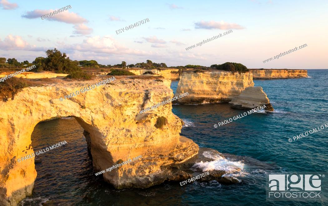 Stock Photo: Meledugno town in Italy, Puglia Region. Spectacular view at sunrise on Santo Andrea cliffs.