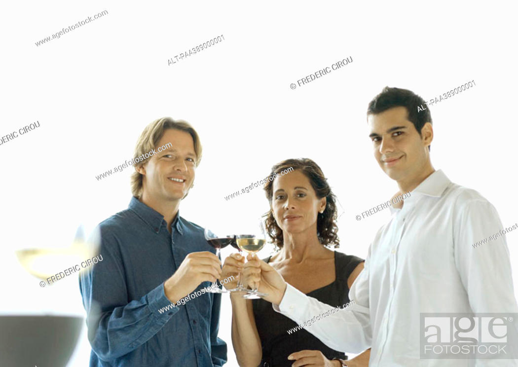 Stock Photo: Three people clinking glasses of wine.