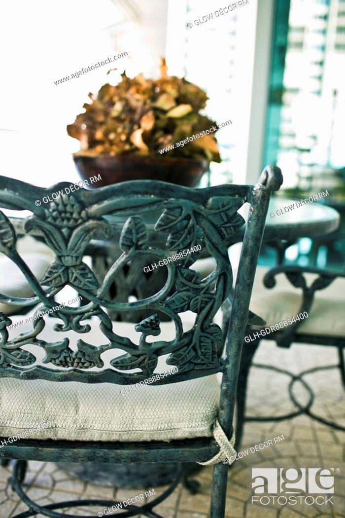 Photo de stock: Close-up of a chair with a table.