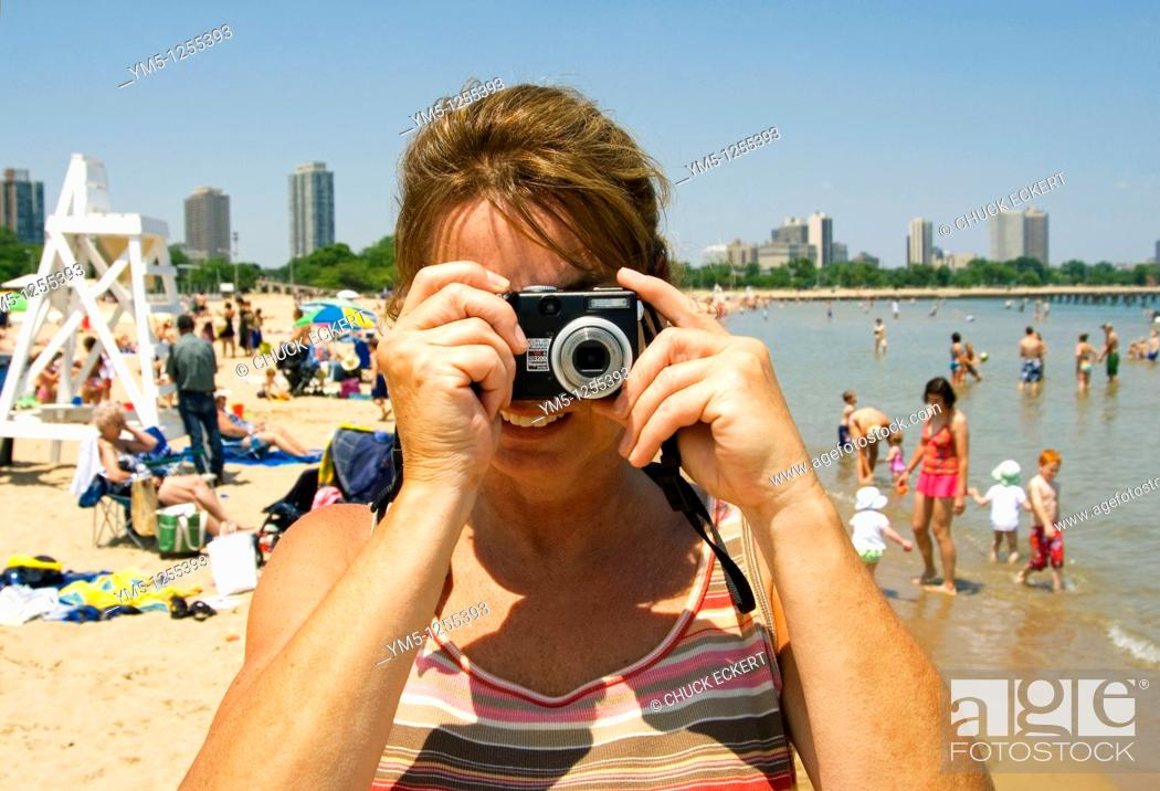 Stock Photo: Woman taking picture opposite another camera taking one of her  North Avenue Beach in Chicago, Illinois, USA.