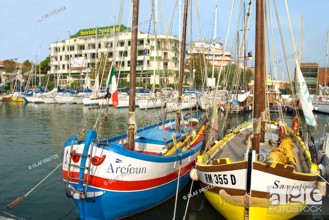 Stock Photo: Traditional colorful fishing boats in the Marina of Riccione, Emilia-Romagna, Italy.