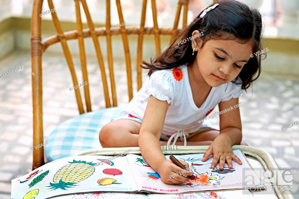 Stock Photo: A young girl doing her home work.