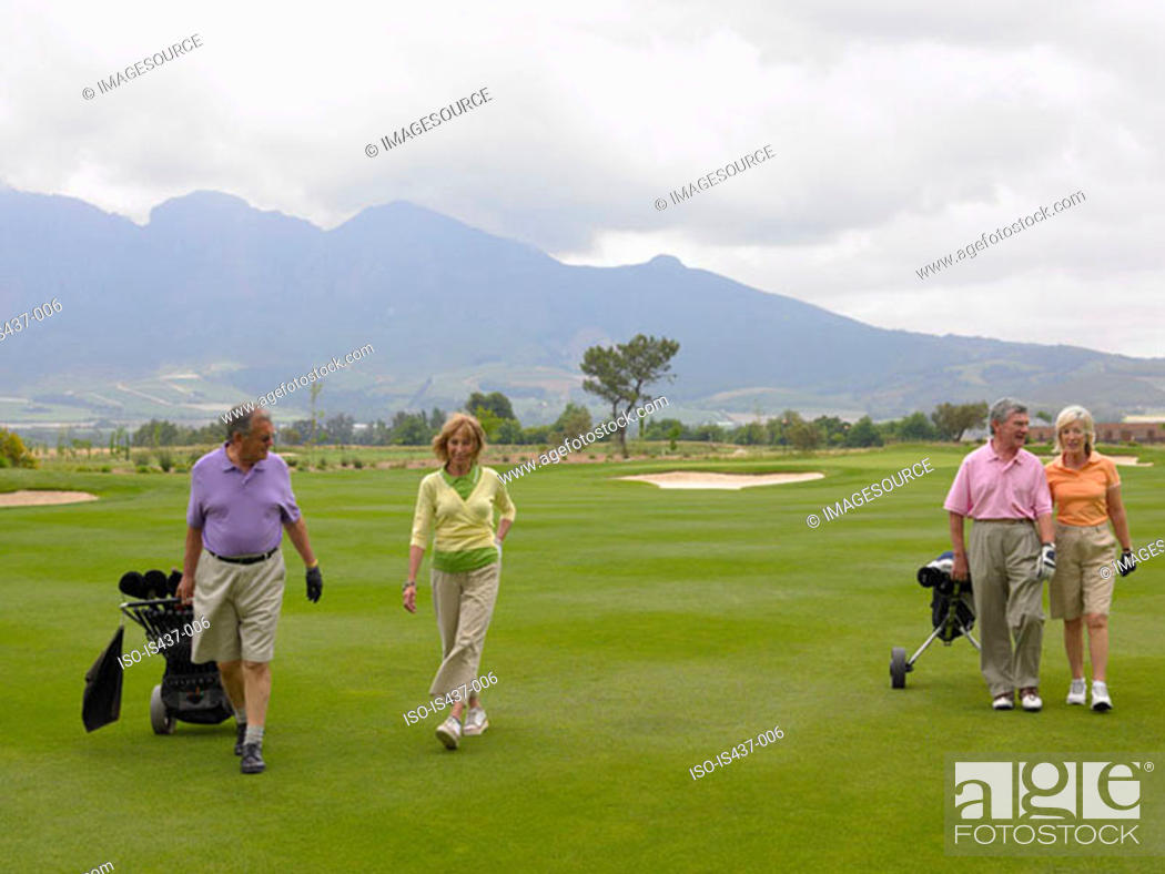 Stock Photo: Senior couples on golf course.