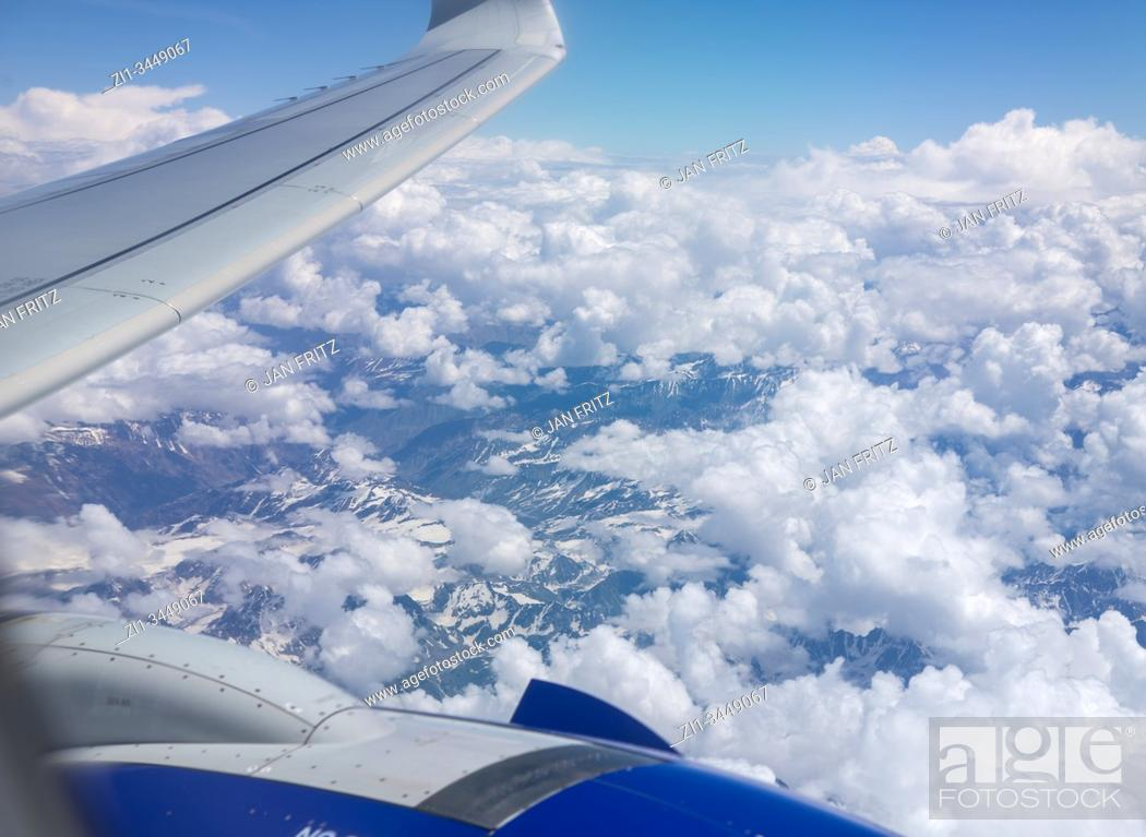 Stock Photo: aerial view from Himalayas with clouds and with wing of plane at Ladakh, India.