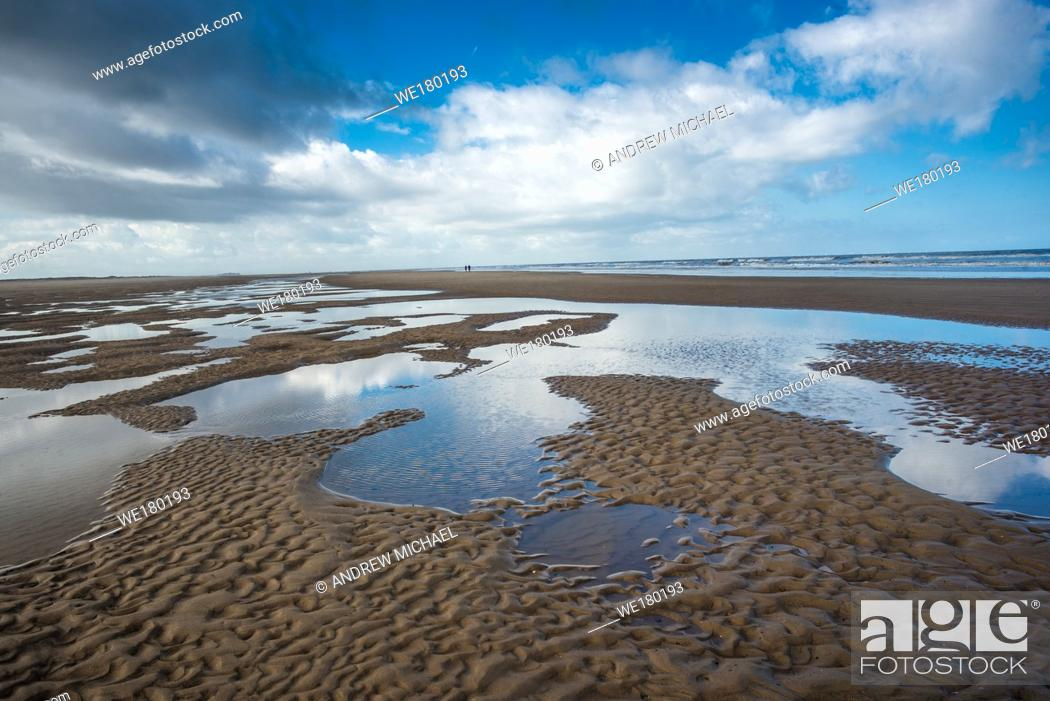 Stock Photo: Patterns made by tide pools of water at low tide on Barnham Overy Staithe beach on Holkham bay, North Norfolk coast, East Anglia, England, UK.