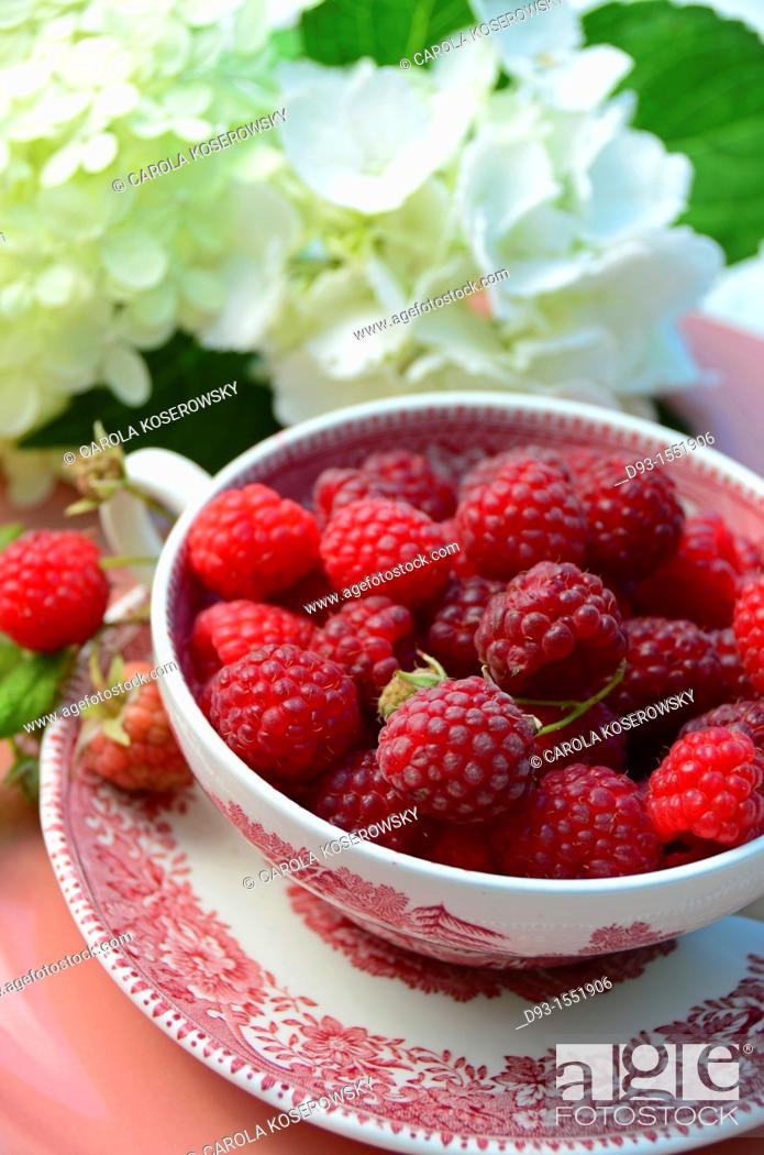 Stock Photo: raspberries in a antique bowl with leaves.
