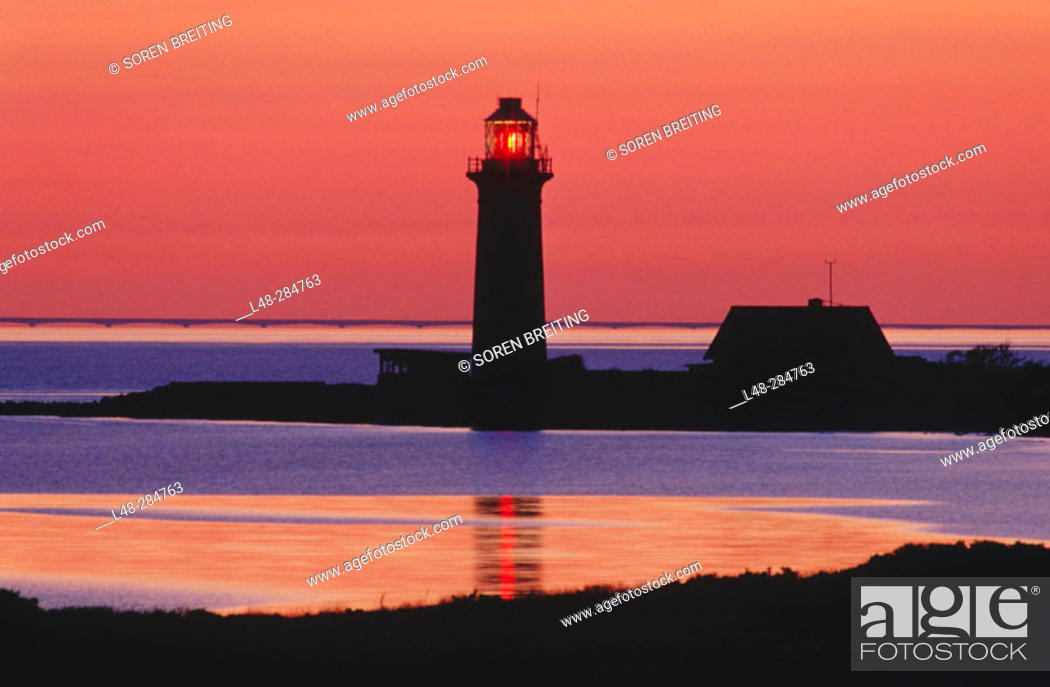 Stock Photo: Lighthouse at sunset at Omoe Island. Denmark.