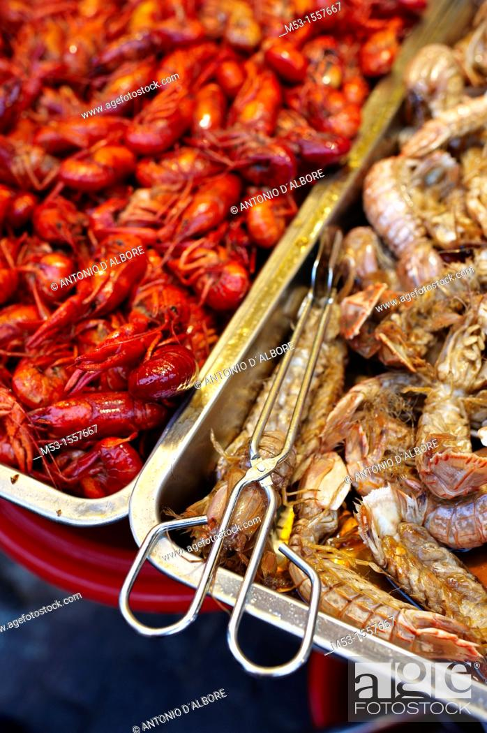 Stock Photo: Trays filled with two kind of shrimps  They are on sale on a street food market.