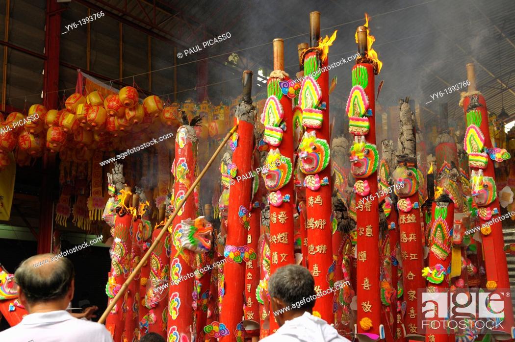 Stock Photo: lighting candles during chinese Vegetarian festival at San Jao Sieng Kong shrine , wat sung heng yee, Chinatown , Bangkok, thailand.