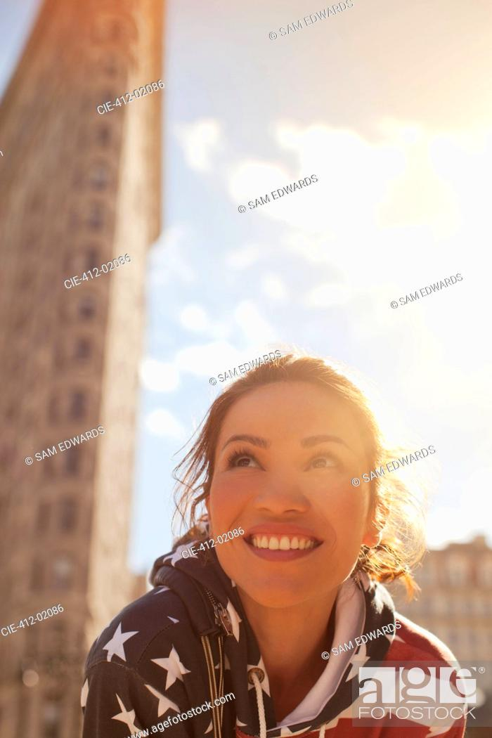 Stock Photo: Smiling woman on city street.