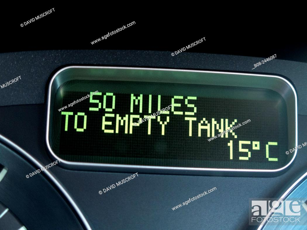 Stock Photo: close up of a car dashboard showing nearly empty fuel tank. Matlock, Derbyshire, Britain.