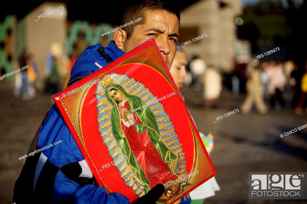 Stock Photo: A pilgrim carries an image of the Our Lady of Guadalupe outside of the Our Lady of Guadalupe Basilica in Mexico City, December 9.