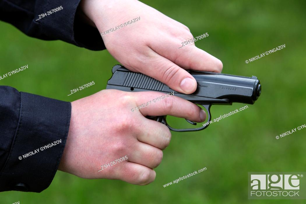 Stock Photo: Russia. A police officer with a gun.