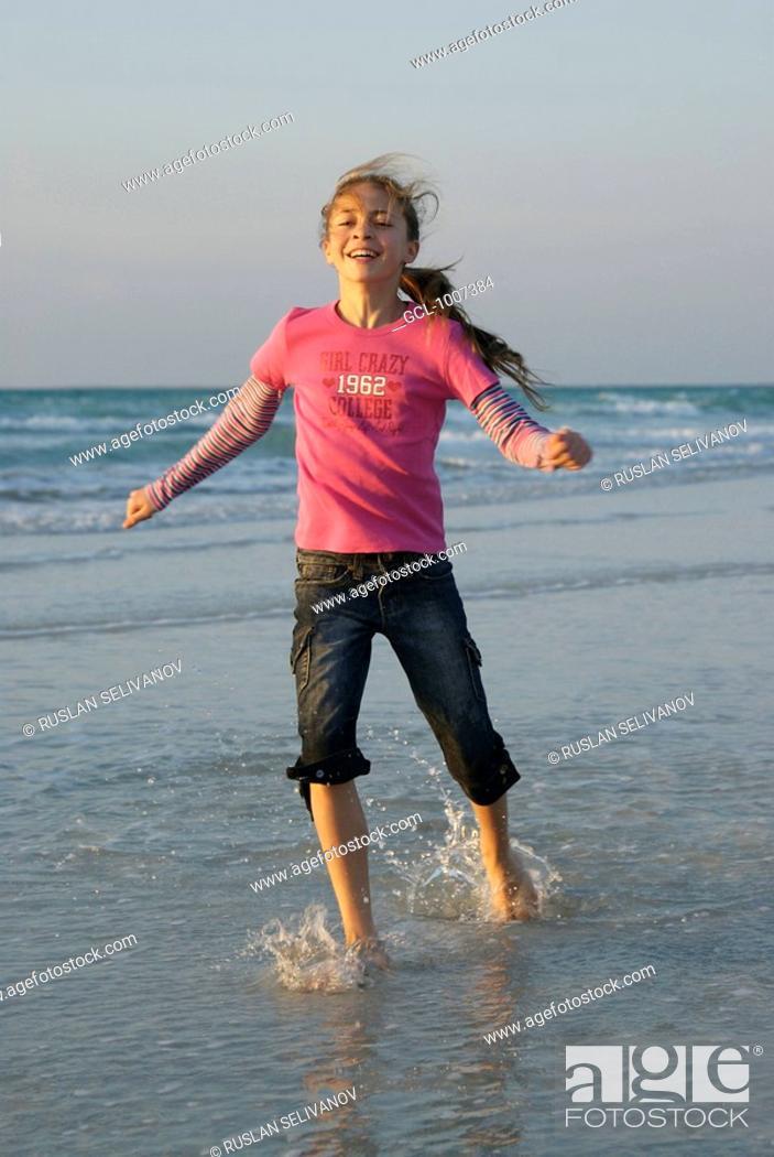 Stock Photo: Happy Girl on the Beach.