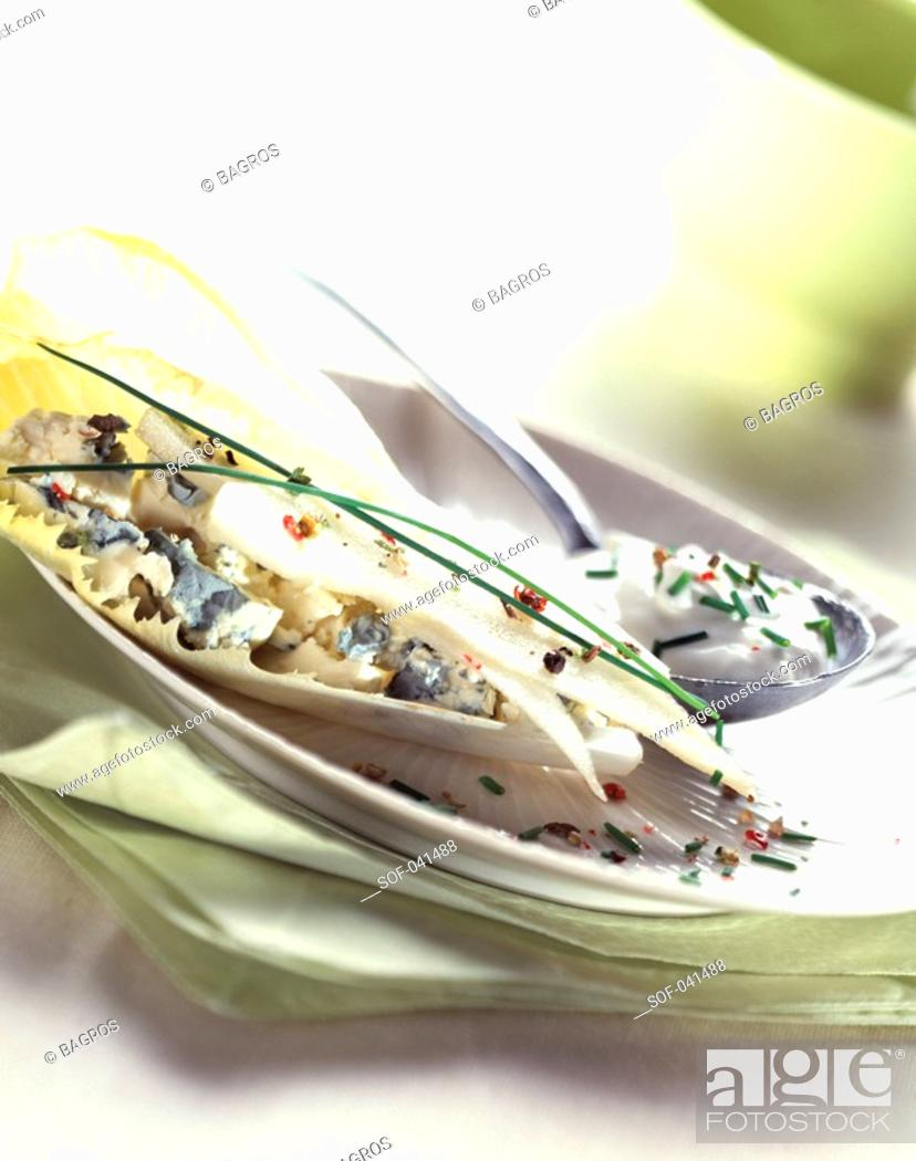 Stock Photo: chicory with pear and roquefort.
