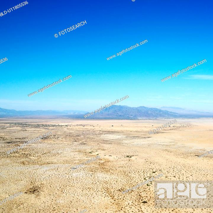 Stock Photo: Aerial view of remote California desert with mountain range in background.