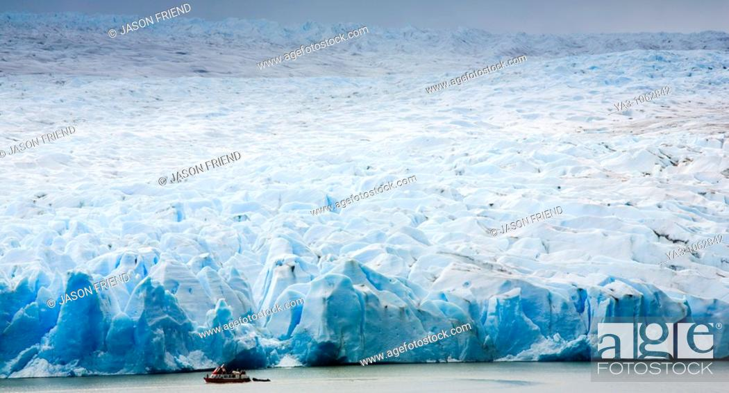 Stock Photo: Chile, Southern Patagonia, Torres Del Paine National Park  Tourist boat on the Lago Grey dwarfed by the sheer ice wall of the Grey Glacier and the Patagonian.