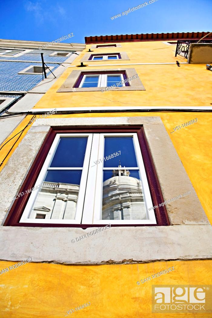 Stock Photo: Reflection of Pantheon in a typical Lisbon facade, Portugal.