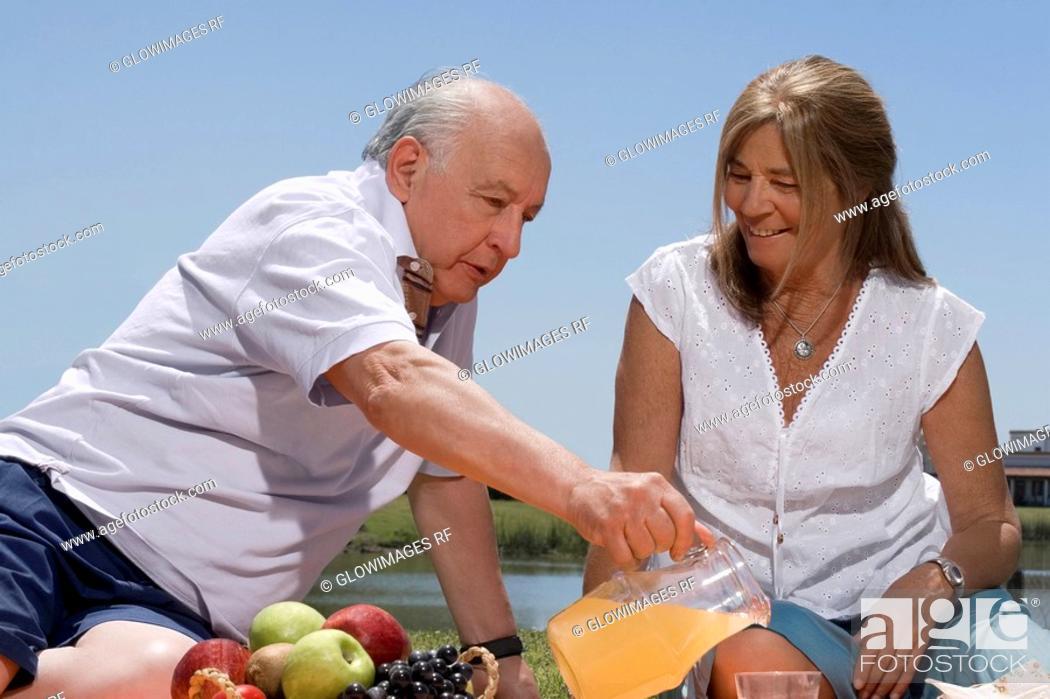 Stock Photo: Senior couple at picnic.