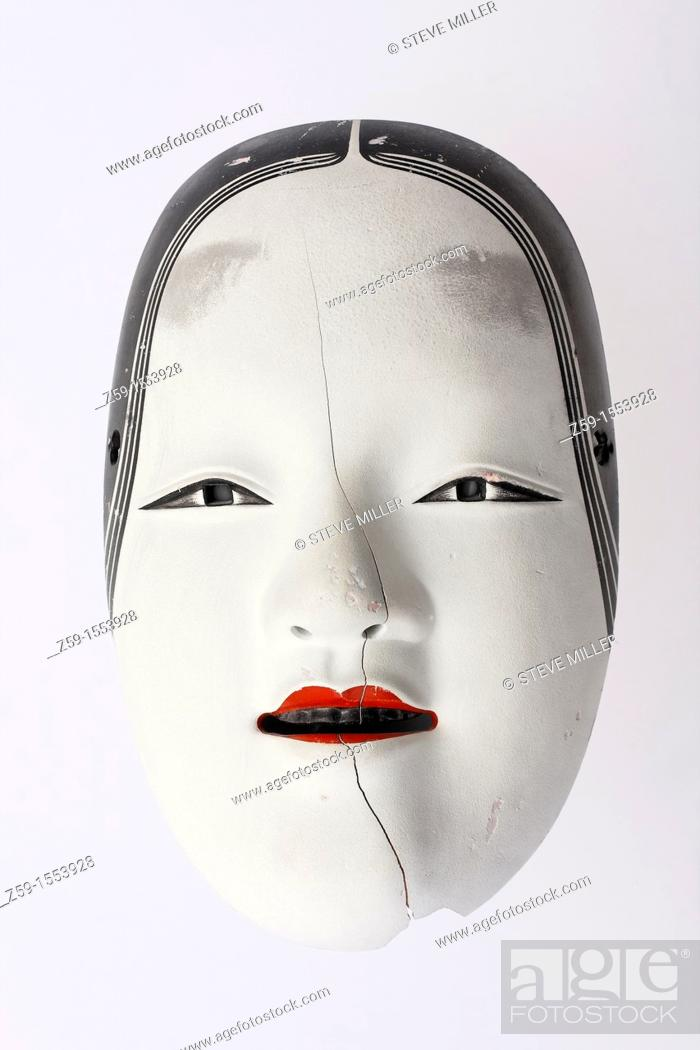 Stock Photo: traditional but broken japanese noh theatre mask of ko-omote representing young beauty woman - symbolism of growing older.