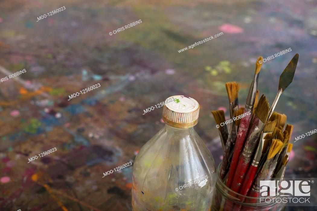 Stock Photo: Artist's Paint Brushes and Bottle by Palette.