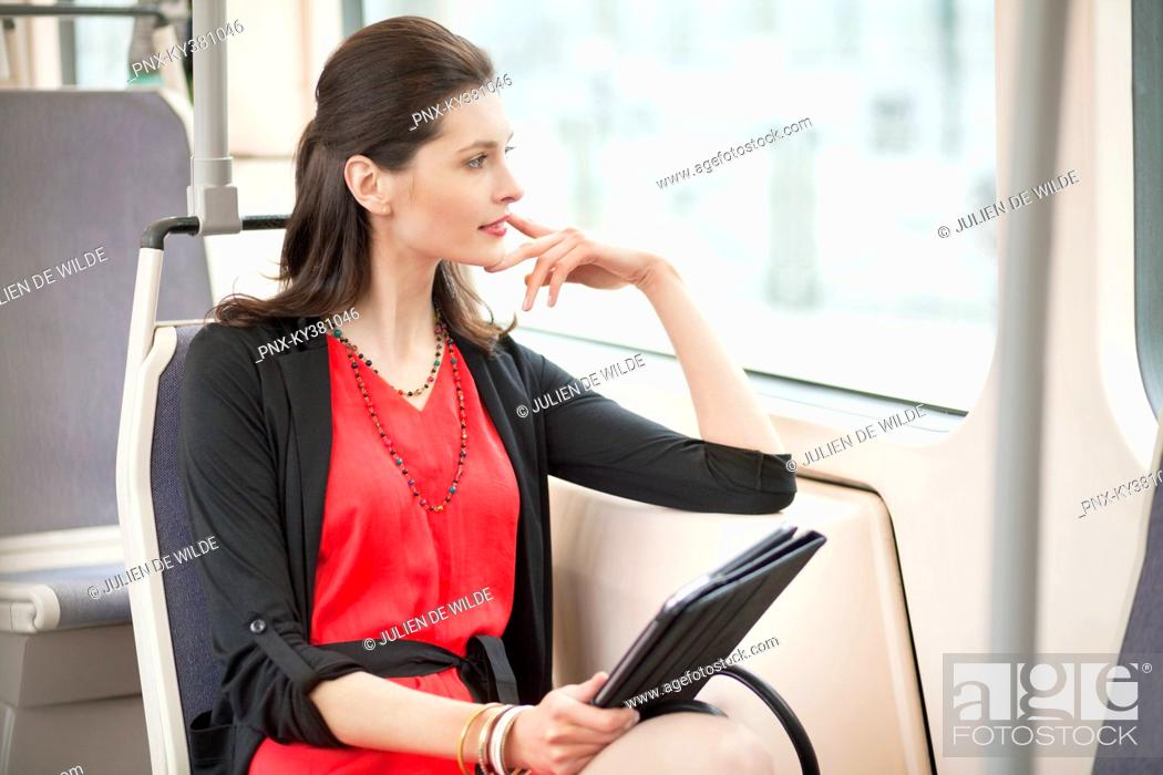 Stock Photo: Woman traveling in a bus and thinking.