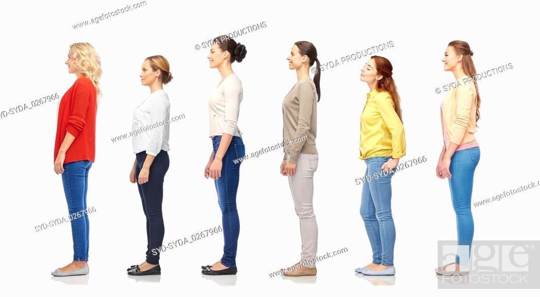 Stock Photo: group of happy women standing in line.
