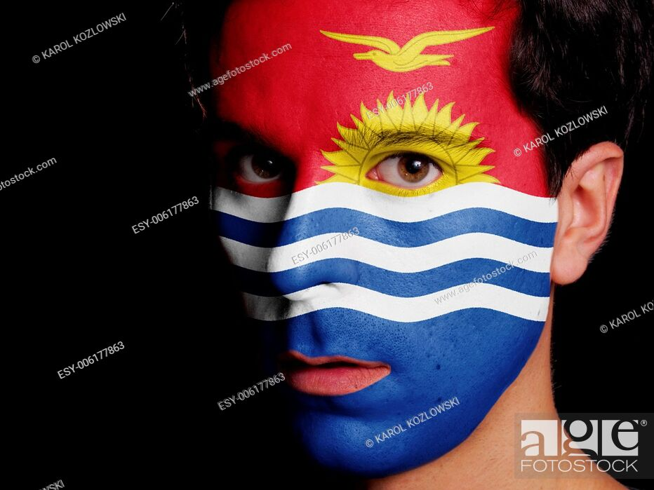 Stock Photo: Flag of Kiribati Painted on a Face of a Young Man.