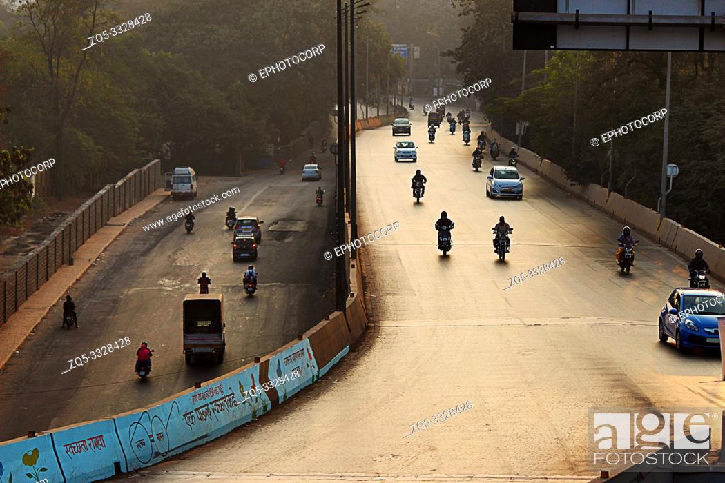 Stock Photo: Early morning traffic on the road, Pune, Maharashtra.