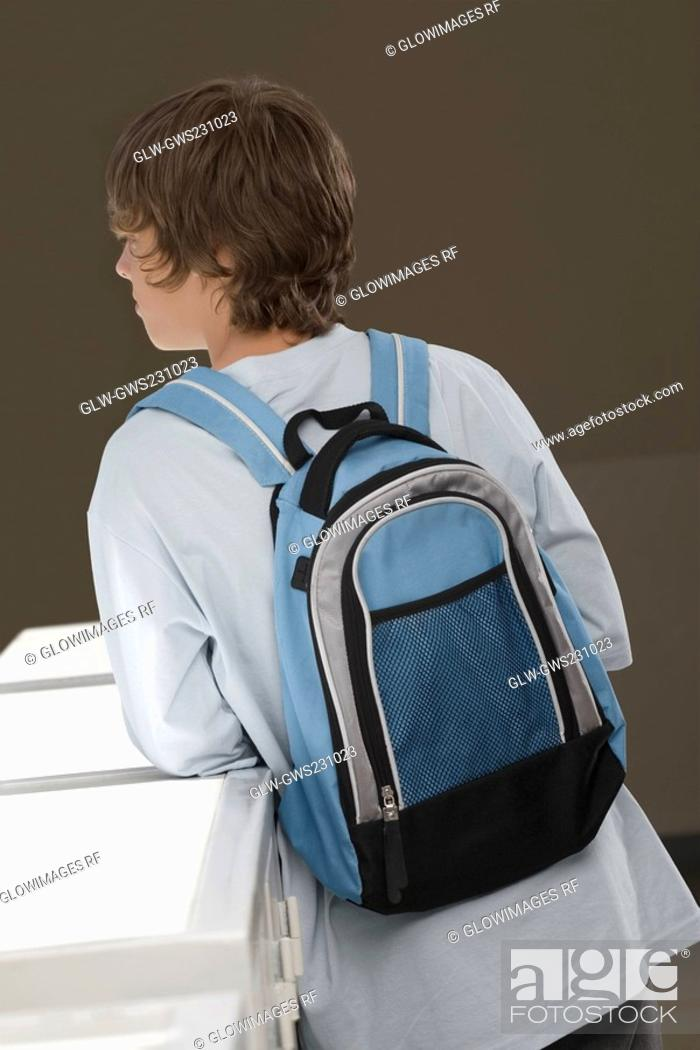 Stock Photo: Rear view of a teenage boy carrying a backpack.