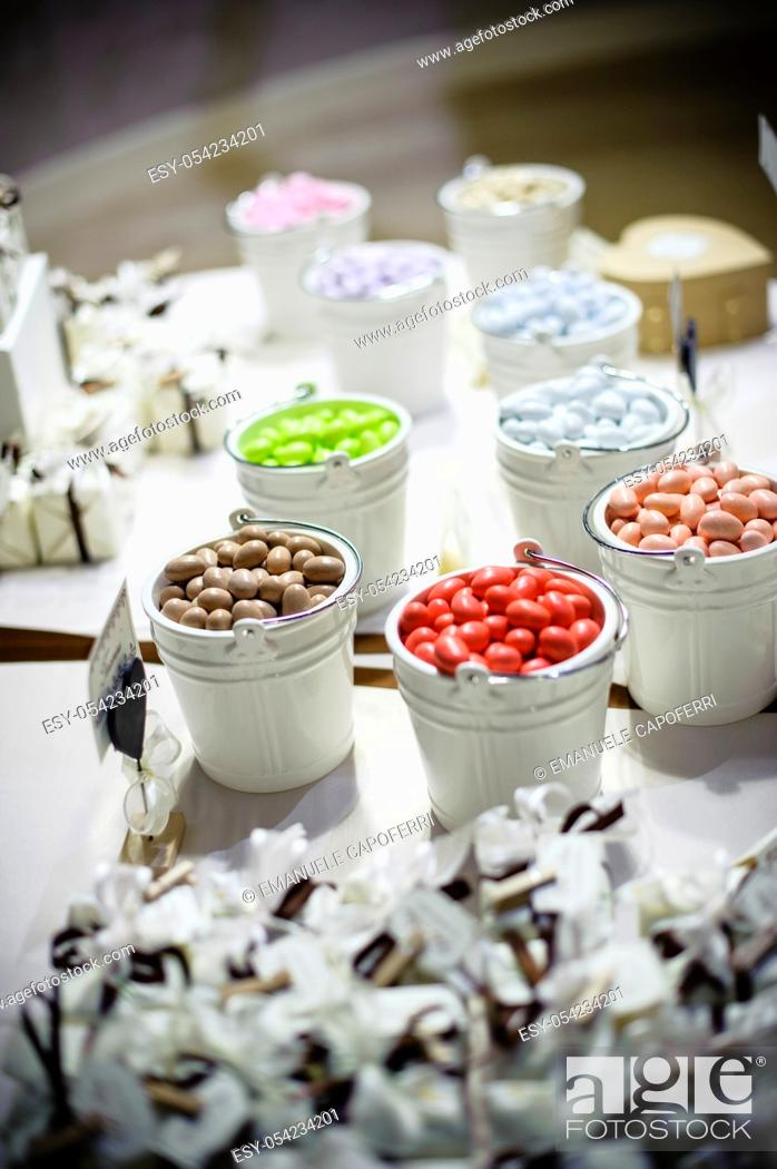 Stock Photo: Confettata, table of the bride and groom with confetti and gifts for the guests.