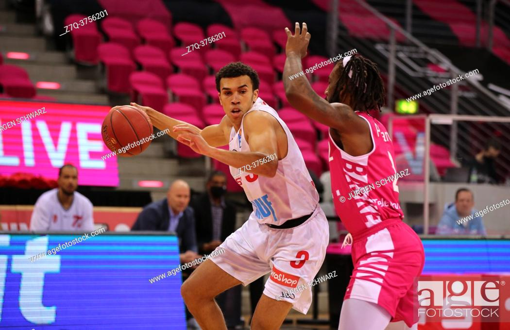 Stock Photo: Bonn, Germany, 09. 01. 2021, Telekom Dome, Basketball Bundesliga, Telekom Baskets Bonn vs s. Oliver Wuerzburg: Tyson Ward (Wuerzburg) und Xavier Pollard (Bonn).