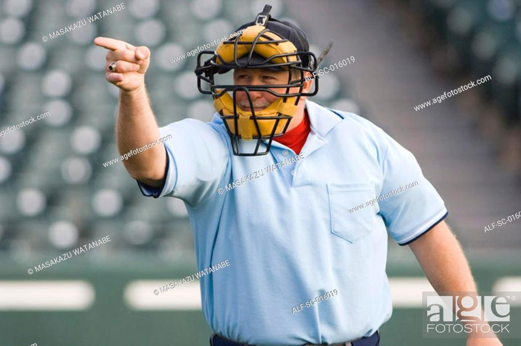 Stock Photo: Umpire calling play.