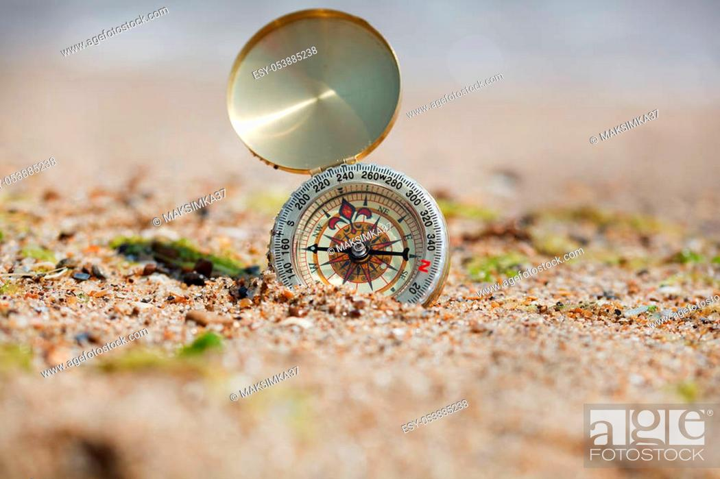 Imagen: Tourist compass on the hot sand.