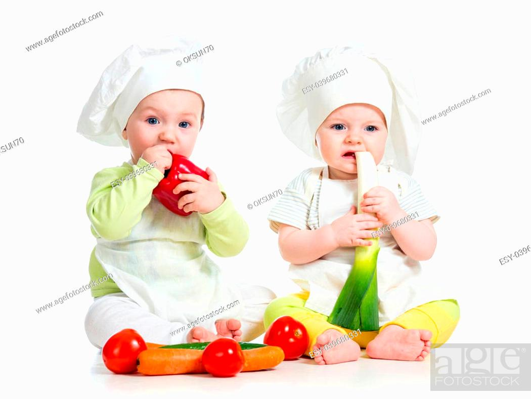 Stock Photo: babies boy and girl wearing a chef hat with healthy food vegetables.