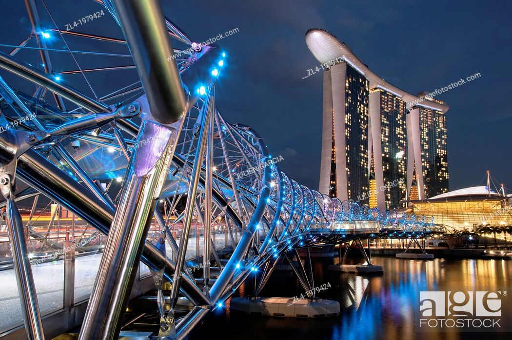 Stock Photo: Marina Bay Sands hotel designed by the architect Moshe Safdie in the evening, viewed from the Helix bridge. Singapore, Marina Bay.