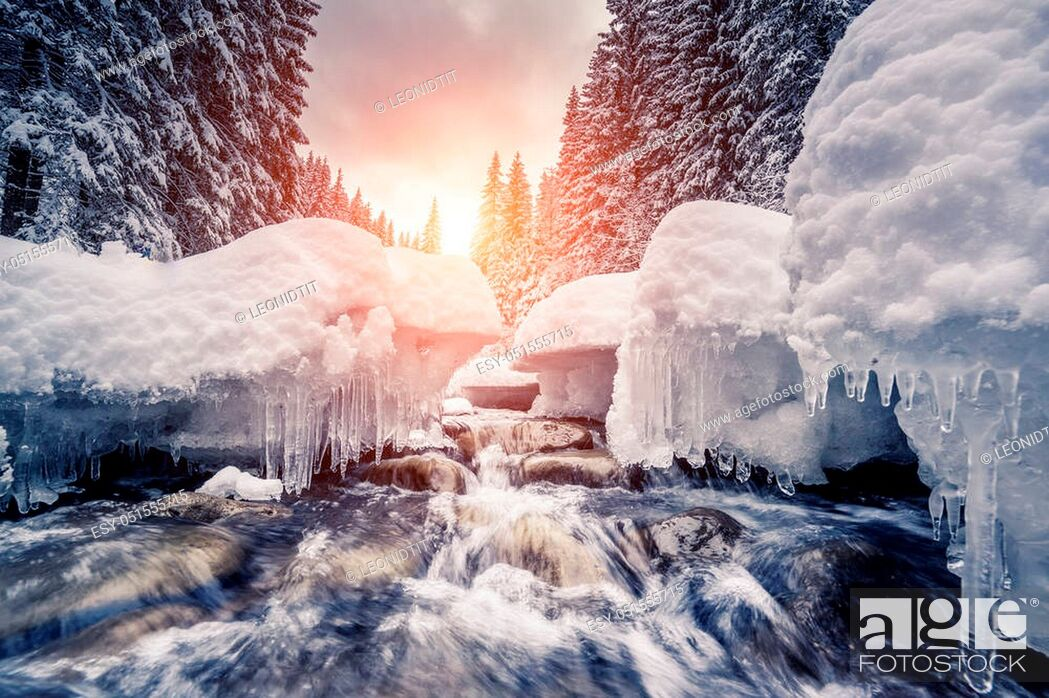 Stock Photo: Miracle river at sunlight in the morning. Dramatic and picturesque wintry scene. Location Carpathian, Ukraine, Europe. Beauty world.