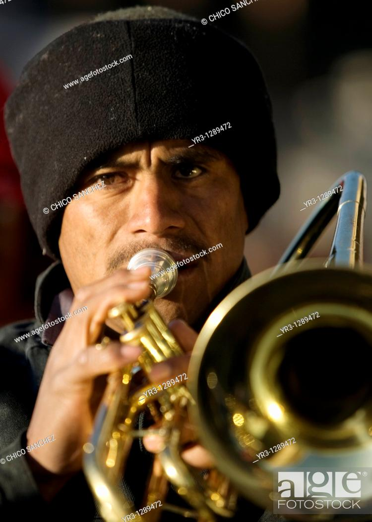 Stock Photo: A trombonist plays outside the Our Lady of Guadalupe Basilica in Mexico City, December 9, 2010  Hundreds of thousands of Mexican pilgrims converged on the.