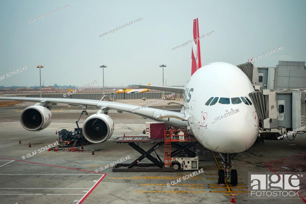 Stock Photo: Singapore, Republic of Singapore, Asia - A Qantas Airways Airbus A380-842 passenger plane with the registration VH-OQB and named after Hudson Fysh is parked at.